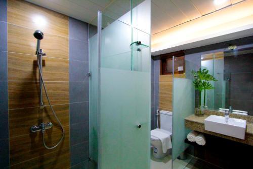 A bathroom at Coron Soleil Garden Resort