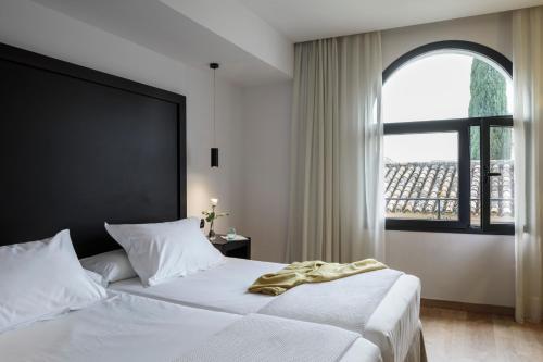 Una habitación en Hotel Fernando III