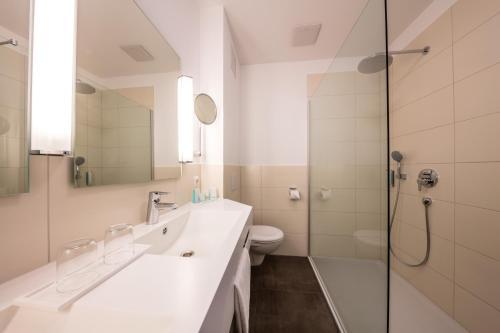 Ein Badezimmer in der Unterkunft Landhotel Endhart
