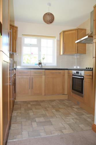 A kitchen or kitchenette at Briquet Cottages, Guernsey,Channel Islands