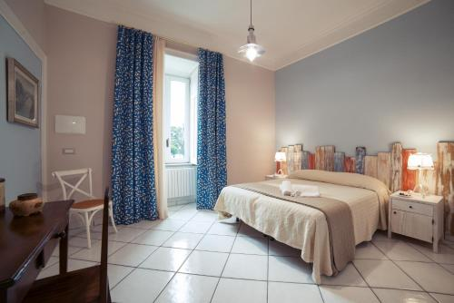A bed or beds in a room at La Tartaruga B&B