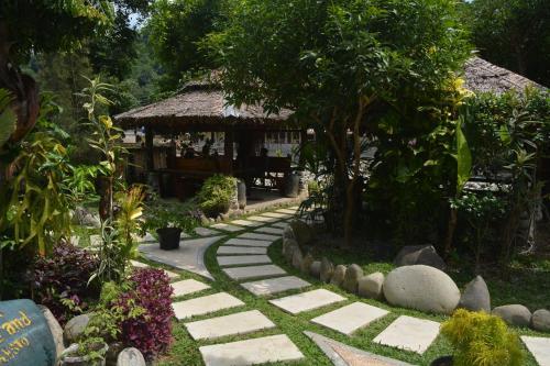 A garden outside Junia Guesthouse Bukit Lawang