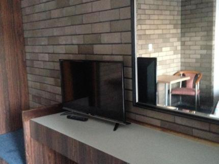 A television and/or entertainment center at Downtown Motel