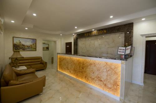 The lobby or reception area at Renion Zyliha Hotel