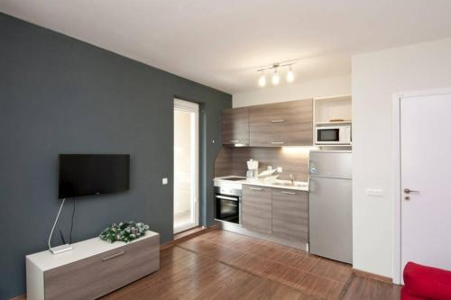 A kitchen or kitchenette at Sofia Top Apartments