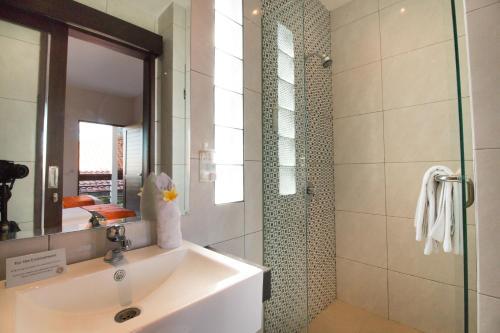 A bathroom at The Pavilion Hotel Kuta