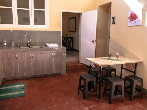 A kitchen or kitchenette at Wild Olive Guest House