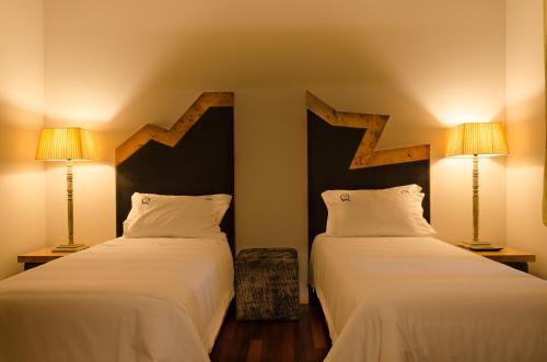 A bed or beds in a room at Quinta do Souto - Casa de Campo