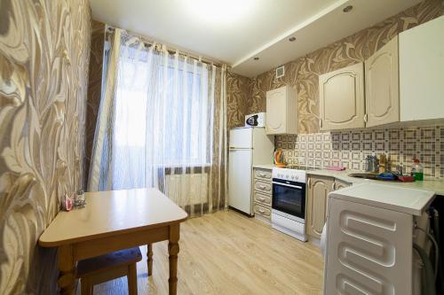 Кухня или мини-кухня в Апартаменты Турист Люкс