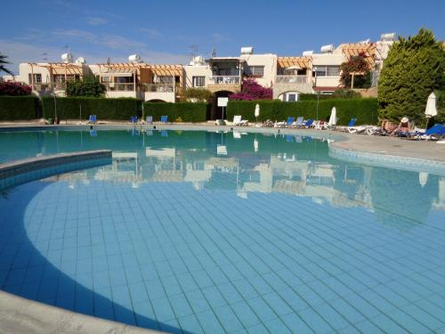 The swimming pool at or near Santa Barbara Complex