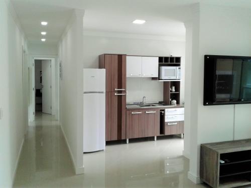 A cozinha ou cozinha compacta de Mediterraneo Home Club