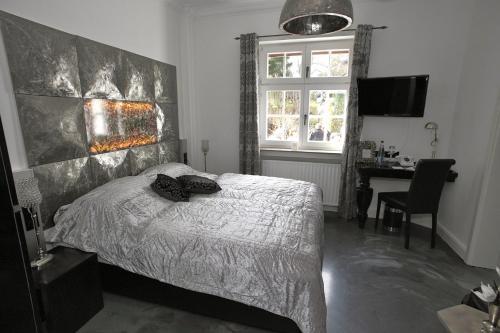 Ein Bett oder Betten in einem Zimmer der Unterkunft VillaAdel.es designrooms