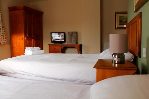 A bed or beds in a room at The Menai Hotel and Bar
