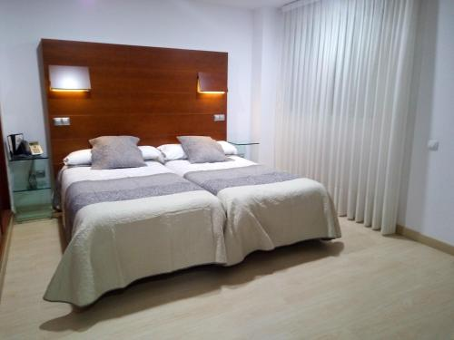A bed or beds in a room at Nap Oviedo