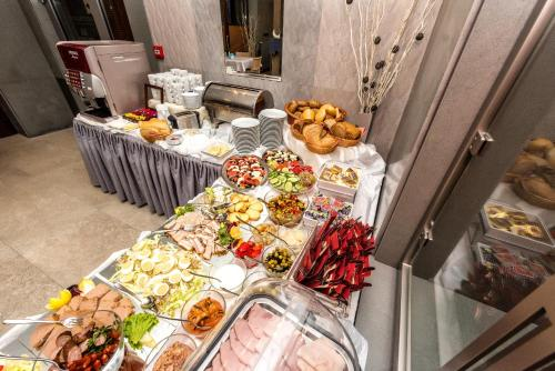 Restaurant ou autre lieu de restauration dans l'établissement Hotel Kazimierz III