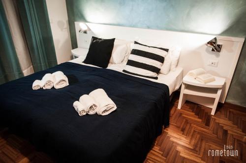 Cama o camas de una habitación en RomeTown B&B