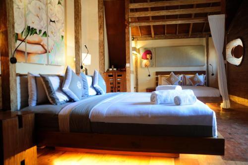 Letto o letti in una camera di Kaleydo Villas