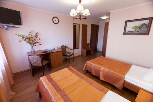 Кровать или кровати в номере Отель Гандвик