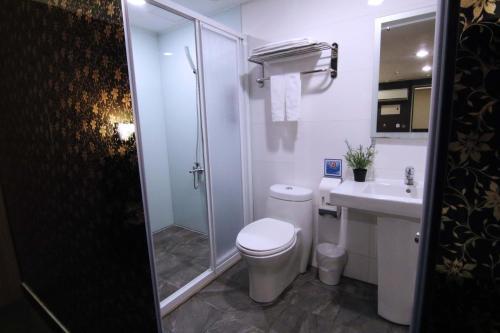 A bathroom at Ecfa Hotel - Wannin