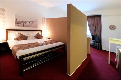 Postel nebo postele na pokoji v ubytování Vila Marica