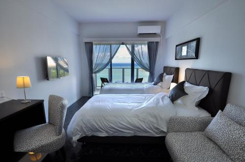 A bed or beds in a room at Beach Front Tower Mihama by DSH