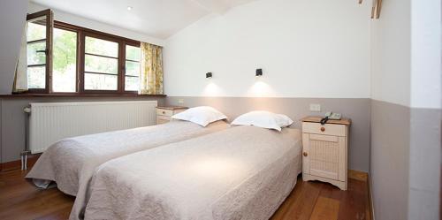 Een bed of bedden in een kamer bij Hotel In't Boldershof
