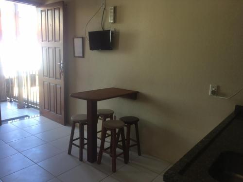 Телевизор и/или развлекательный центр в Nascer Do Sol Suites