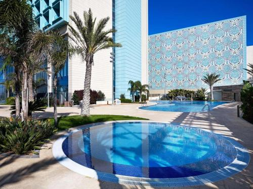 The swimming pool at or near Le Meridien Oran Hotel