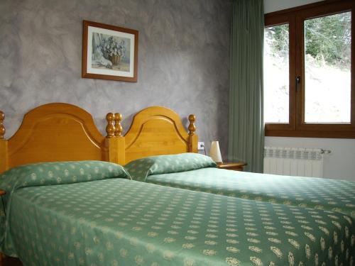 A bed or beds in a room at Apartaments Turistics Sant Roma
