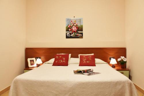 A bed or beds in a room at House Carla by Holiday World