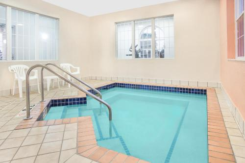 The swimming pool at or near Microtel Inn and Suites by Wyndham Appleton