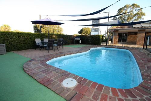 The swimming pool at or near Pevensey Motor Lodge