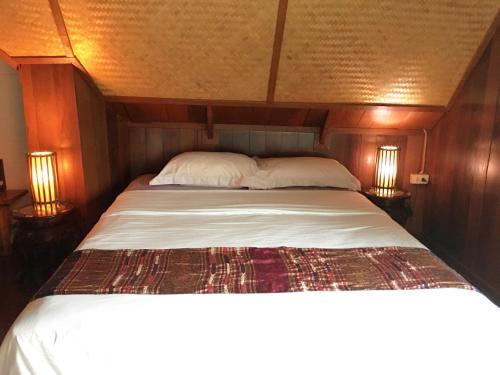 Ein Bett oder Betten in einem Zimmer der Unterkunft La Madrague
