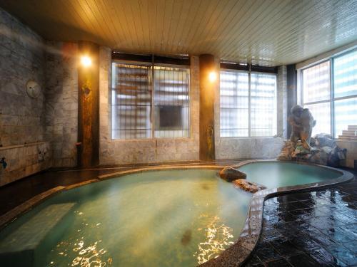 Het zwembad bij of vlak bij Kosekiya Bekkan