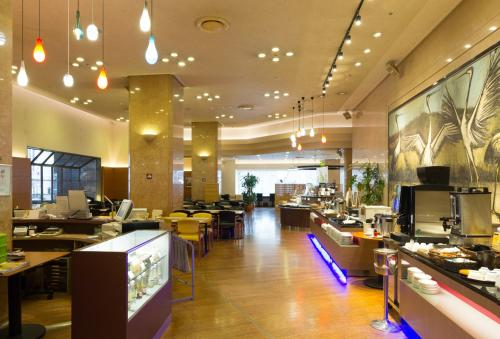 A restaurant or other place to eat at New Otani Inn Sapporo
