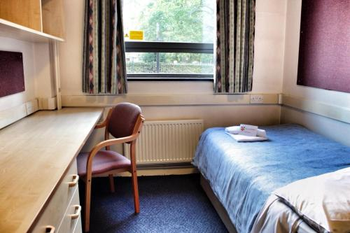 A bed or beds in a room at International Hall / University of London