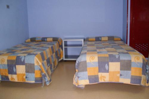 A bed or beds in a room at Mañarikua Hostelling International