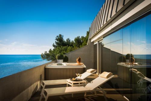 A balcony or terrace at Rivalmare Boutique Hotel