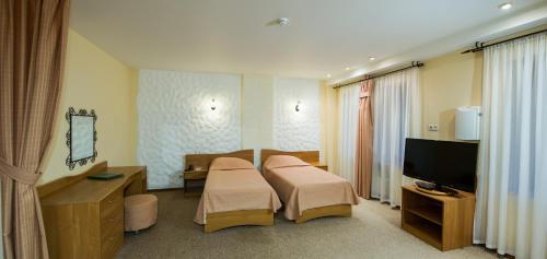 Кровать или кровати в номере Загородный клуб «Дача»