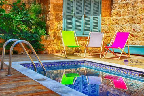The swimming pool at or near Via Mina Hotel
