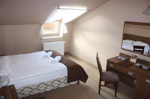 Кровать или кровати в номере Paria Hotel