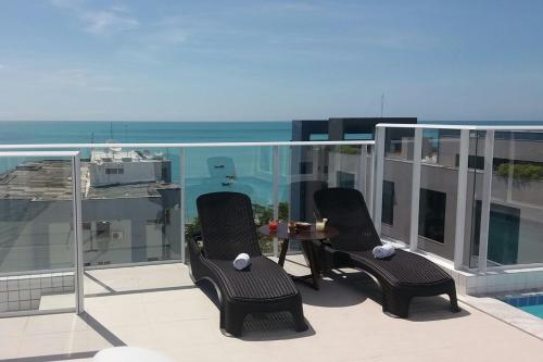 Uma varanda ou terraço em Slim Pajuçara by Tropicalis