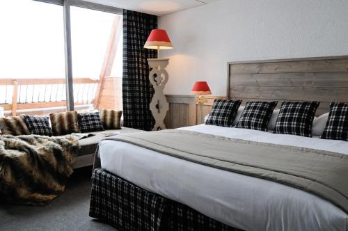 Un ou plusieurs lits dans un hébergement de l'établissement Hôtel Arcadien