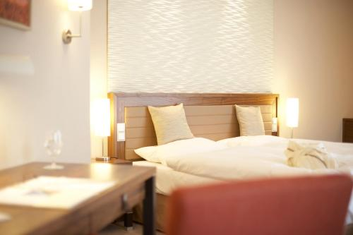 A bed or beds in a room at Iberotel Boltenhagen