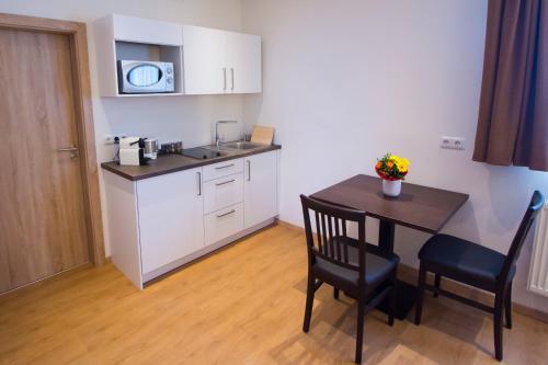 Küche/Küchenzeile in der Unterkunft Gästehaus am Lindenhain