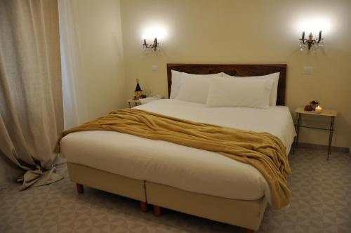 Letto o letti in una camera di Casa Ardizzoni