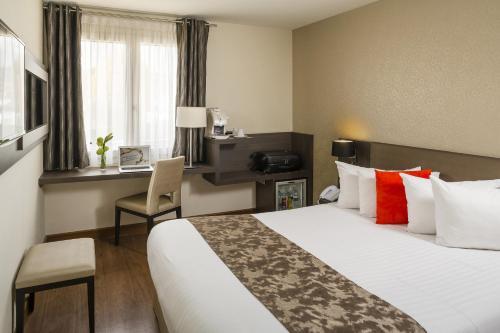 Postel nebo postele na pokoji v ubytování Best Western PLUS Elixir Grasse