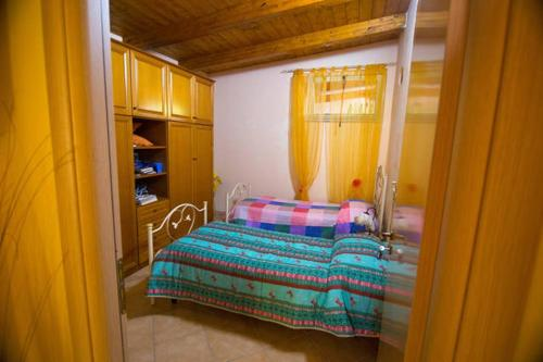 Letto o letti in una camera di B&B Benvenuti al Sud