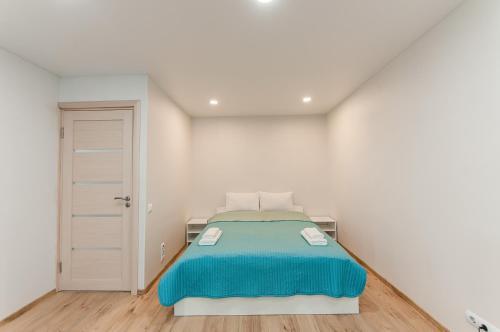 Кровать или кровати в номере Business Class Apartments