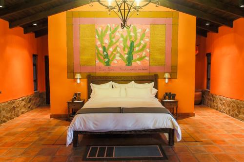 A bed or beds in a room at Sol y Luna - Relais & Chateaux